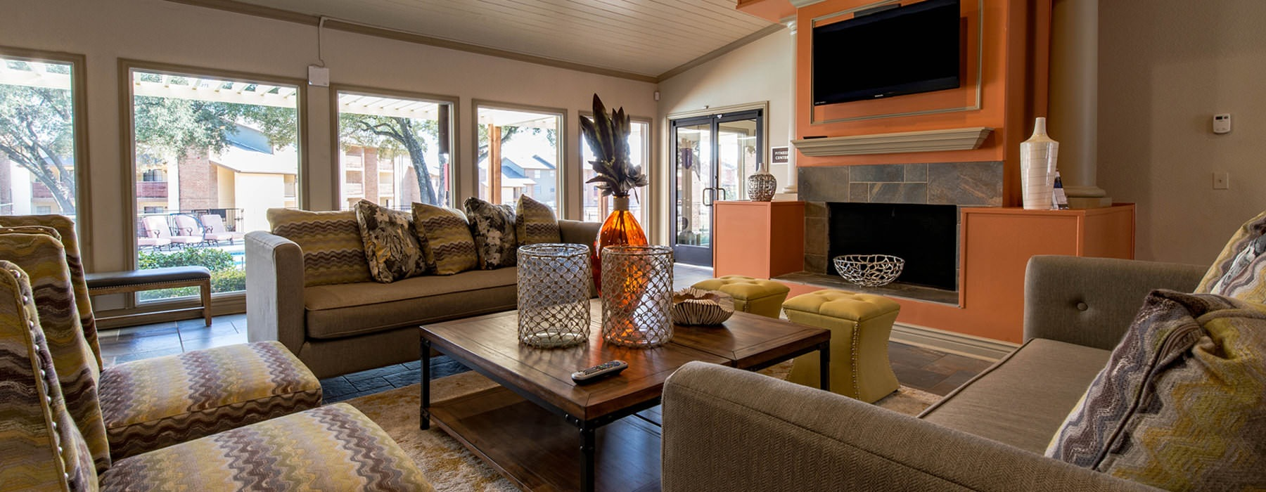 Comfortable Club Lounge with mounted tv over fireplace
